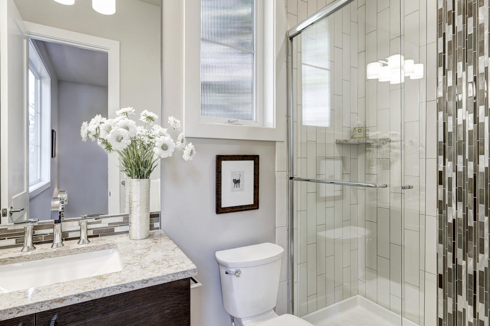 Bathroom with subway tile shower