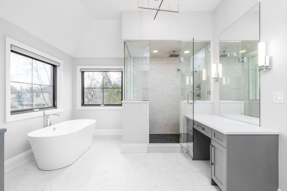 Bathroom with walk in shower and bath tub