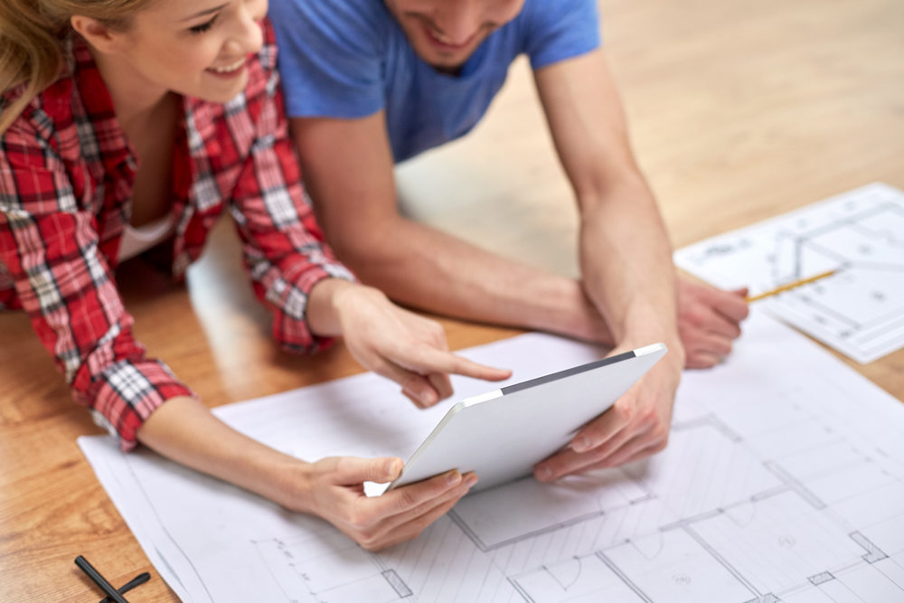couple-holding-ipad-home-renovation